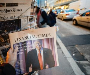 65923016 - paris, france - nov 10, 2016: man buying financial times newspaper with shocking headline title at press kiosk about the us president elections - donald trump is the 45th president of united states of america